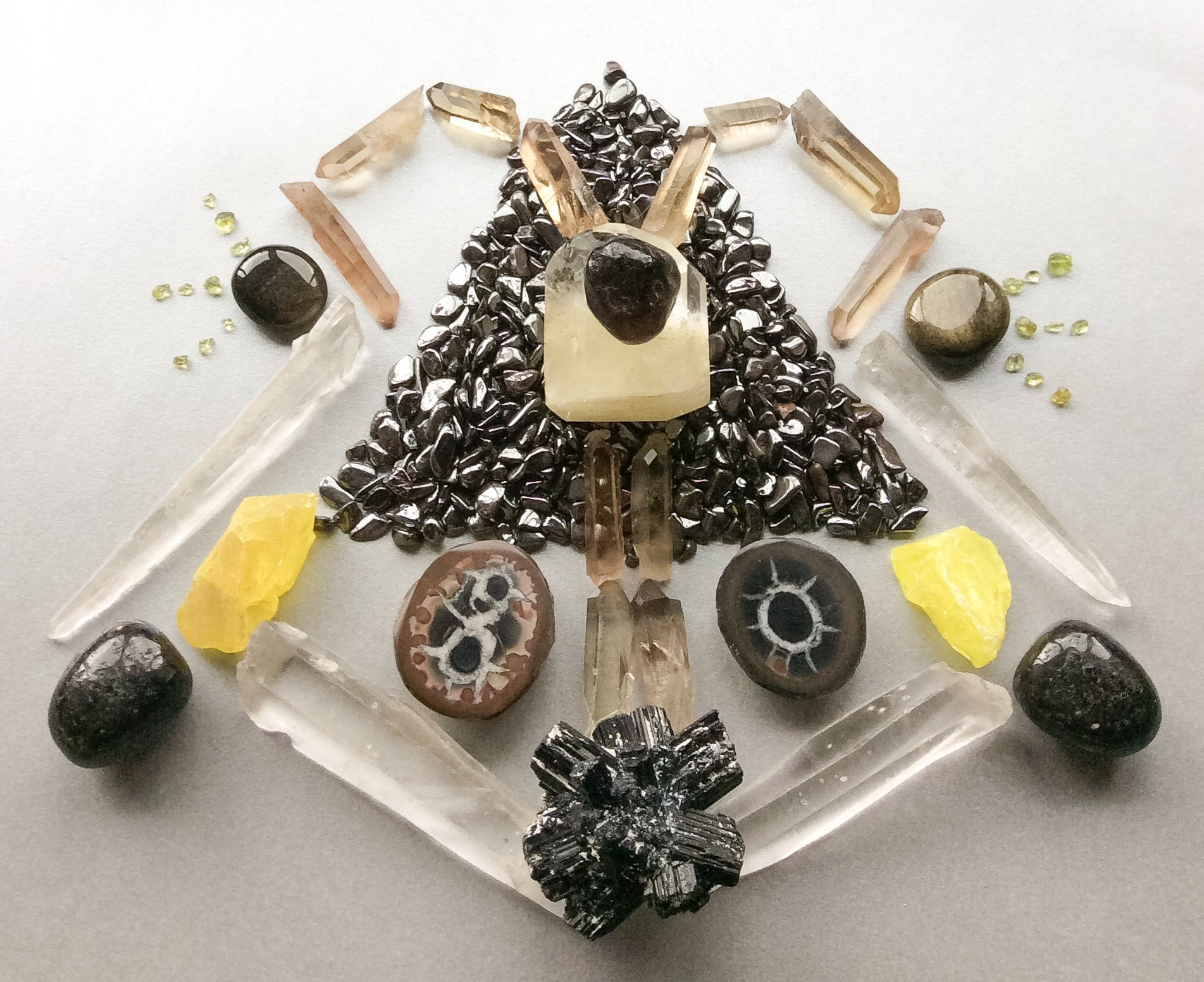 Apache Tear, Sulphur in Quartz, Hematite, Smokey Lemurian Quartz, Golden Sheen Obsidian, Peridot, Septarian, Sulphur, Nuummite, Laser Quartz and Schörl