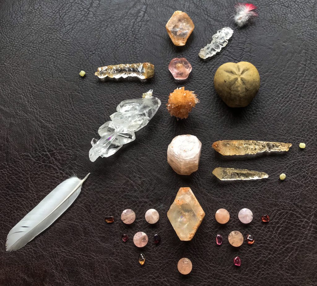 Morganite, Creedite, Faden Quartz, Dissolved Quartz, Rhodozite, Tourmaline, Micraster corcolumbarium and Feathers found