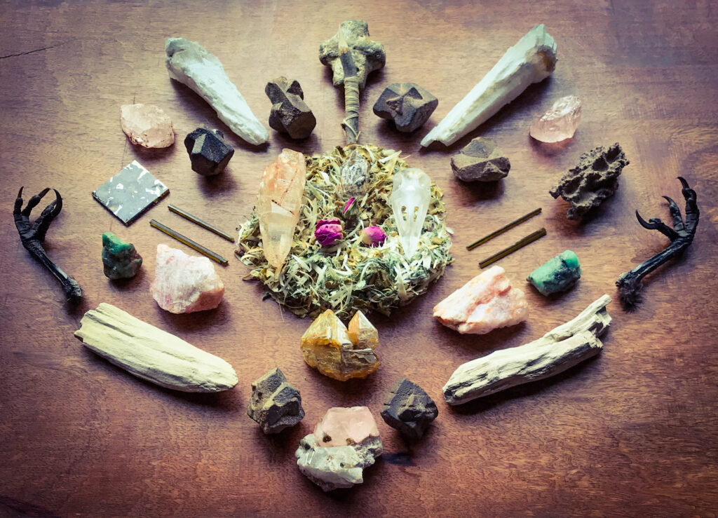 Shavings of the Willow of my Drum Sounder with dried Roses, A Hawthorn sprig with seven golden Horse hairs, Staurolite, White Druide Quartz, Quartz, Morganite, Dravite, Seycham Pallasite, Emerald, Celestial Fenster Quartz, Petrified Wood and Crow claws