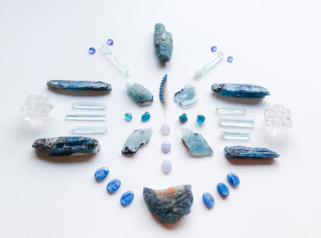 Indicolite, Blue Lace Agate, Barite, Jay Feather, Aquamarine, Kyanite, Sapphire, Quartz, Tanzanite, and Sunstone in Iolite
